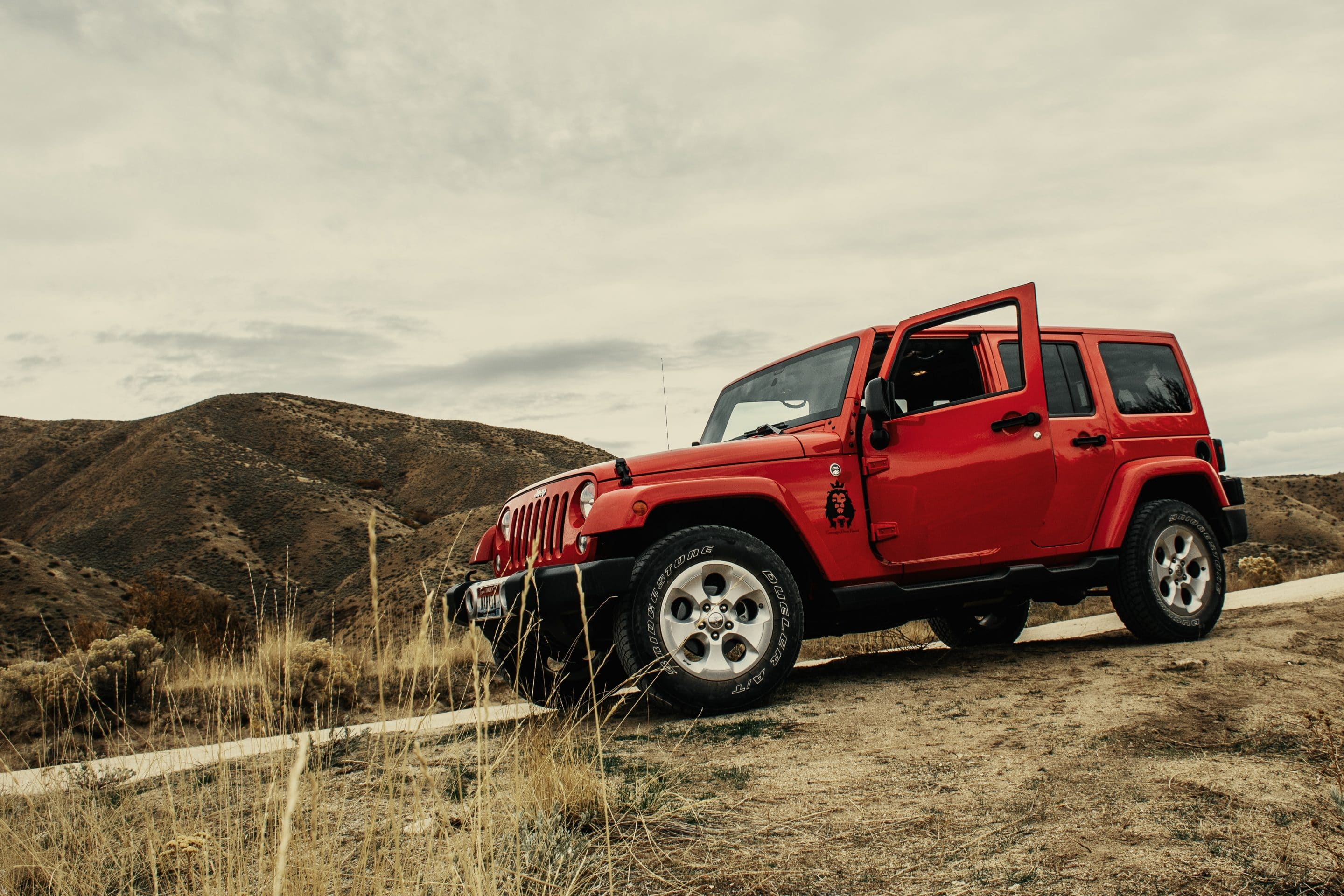 Red vehicle in the desert